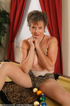 Short hair MILF Judy exposes her hairy pussy on the pool table
