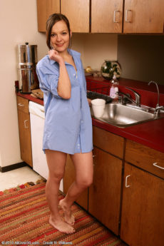 Petite housewife Camilla shows her perfectly bald pussy in the kitchen