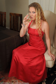 Elegant blonde MILF Daisy L loses her red dress to reveal her meaty pussy lips