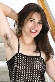 All natural MILF Shelby strips out of her body stocking to show her hairy pits and pussy
