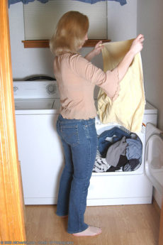 Innocent looking redhead housewife Carrie removes her jeans and her satin panties