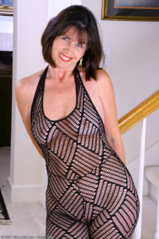 Knockout 53 year old Jade takes off her bodystocking and spreads her pussy