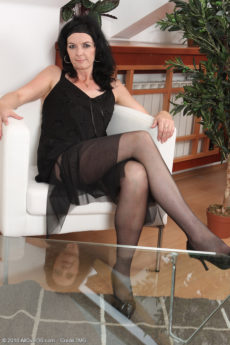 Mary-Sue takes off her lacey panties and spreads her stockinged legs