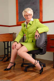 Mature blonde teacher Sally T from AllOver30 prepares for her first lesson