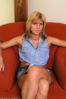 Monica pulls her white panties aside revelaing her thick bush