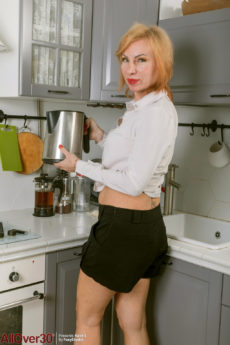 Redhead over 40 MILF Kate S getting naked in the kitchen
