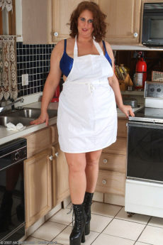 Big and busty Dusty pulls aside her apron and shows her big tits ahd furry snatch