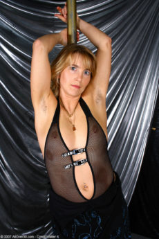 Hairy pussy stripper Kate M hits the pole and does her sexy routine