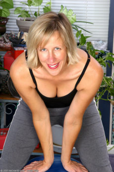 Long legged blond Julia has fun playing with her mature pussy after yoga