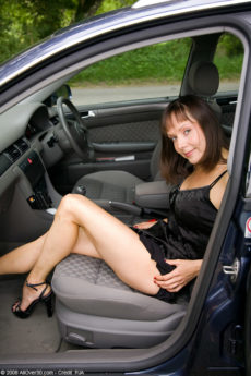 Petite 41 year old brunette cutie Cindy spreads her long legs in the car