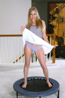 Fun loving housewife Bailey T jumps on a trampoline exposing her pussy