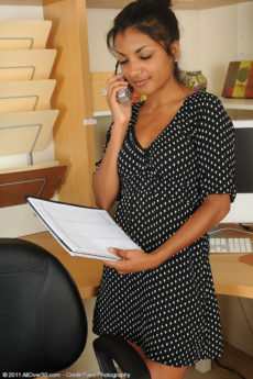 Sexy petite and exotic Neela peels off her office attire and panties after a hot phonecall