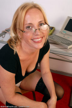 Smoking hot blonde mom Katrina wearing glasses and looking cute in her stockings