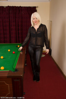 Blonde 43 year old mature babe Amber Jewell shows her pretty feet and big ass on the pool table