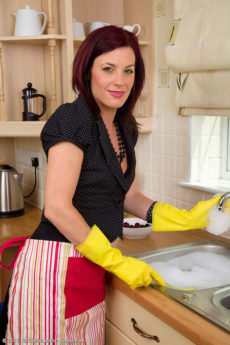 Beautiful red haired housewife Sofia gets busy in the kitchen in her stockings