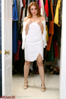 Fun loving redhead MILF Stephanie Swan puts on her hot body stocking