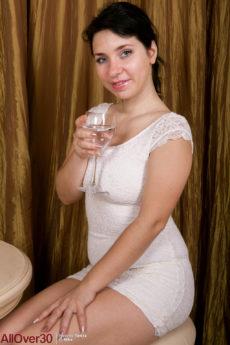 Plump ass brunette MILF Tanita takes off her elegant white dress revealing her hairy pussy