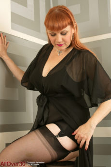 Stacked chubby 43 year old redhead Velvetina Fox plays in stockings and corset