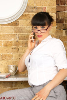 Horny secretary Lucy Love strips to reveal her floppy tits and big butt