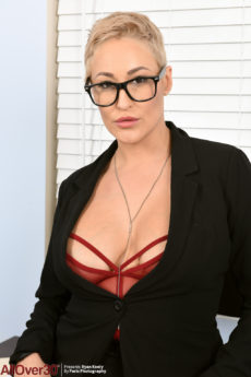 Thicc secretary Ryan Keely looking amazing in glasses and lingerie